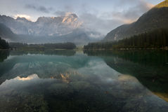 Alpine lake,Sunrise over the alpine lake Laghi di Fusine Royalty Free Stock Images
