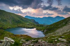 Alpine lake at sunset Stock Photo