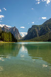 Alpine lake with valley in the back Stock Photo