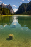 Alpine lake with valley in the back Stock Photography