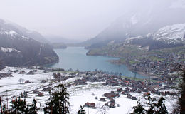 Alpine lake and village in winter(Switzerland) Royalty Free Stock Photography