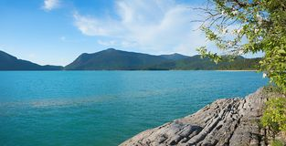 Alpine lake walchensee with turquoise water and rocky shore Royalty Free Stock Image