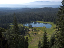 Alpine Lake and wide meadow Stock Photo