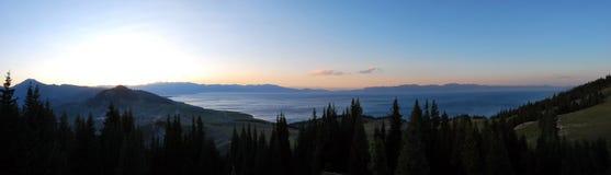 Alpine lakes. A highland lakes Northwest China Plateau sunset Fir tree Prairie lake stock photo