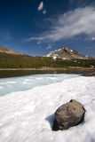 Alpine lakes and Mountains in. A frozen alpine Lake and Mountains in the high Sierra near the Yosemite National Park In California stock photography