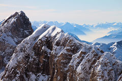 Alpine Landscape. View of snow covered mountain range in the Swiss Alps. Mount Titlis, Engelberg, Switzerland royalty free stock images