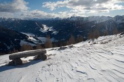 Alpine landscape. Winter landscape with the bench in austrian alps Royalty Free Stock Photos