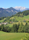 Alpine landscape. Mountain village and Julian Alps in the background, Slovenia Royalty Free Stock Image