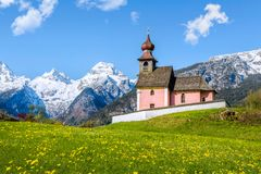 Alpine landscape with chapel and snow-capped mountains at Lofer, Austria. Alpine landscape with chapel and mountains at Lofer, Austria Royalty Free Stock Photography