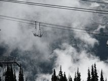 Alpine landscape of clouds and ski lift Stock Images