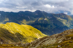 Alpine landscape in a cloudy day. Landscape with rocky mountains and hiking trail Stock Images