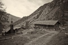 Alpine Landscape with cottages Royalty Free Stock Photo