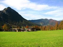 Alpine landscape. In Germany, near Berchtesgaden. It has a large green grass area with a mountain in the background Stock Photo