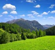 Alpine landscape with mountain range. Royalty Free Stock Photos