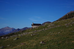 Alpine landscape. Mountain landscape with a rural hut in the italian Alps Royalty Free Stock Images