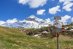 Alpine landscape and path signs Royalty Free Stock Photo