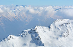 Alpine landscape with peaks covered by snow and clouds Royalty Free Stock Photography