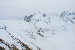 Snowy mountain ridge with sliding glacier in Swiss Alps stock photography