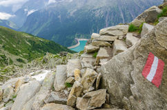 Alpine landscape and trail Zillertal Alps, Austria. Beautiful alpine landscape with trail blazing and azure mountain lake in the background, Zillertal Alps Stock Image