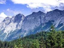 Alpine landscape: the view over the green valley, mountains and Royalty Free Stock Photography