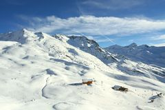Alpine landscape. Winter time sun snow in Alps royalty free stock photography