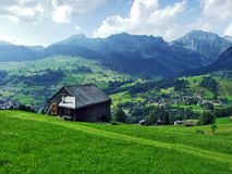 Alpine livestock farms and stables on the slopes of Churfirsten mountain range in the Toggenburg region. Canton of St. Gallen, Switzerland stock photography