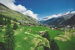 Alpine meadow with houses Stock Photo