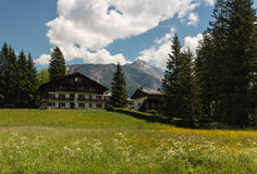 Alpine meadow with mountain huts Stock Photos