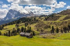 Alpine meadows and mountain huts on the Alpe di Siusi Stock Photography