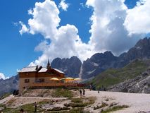 Alpine mountain hut in summer royalty free stock photo