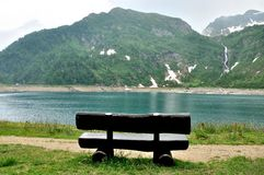 Alpine mountain lake bench Stock Photos
