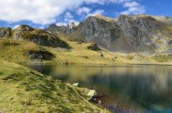 Alpine mountain lake Gentau under the peak Larry Stock Image