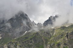 Alpine mountain peaks clad in clouds Stock Photography