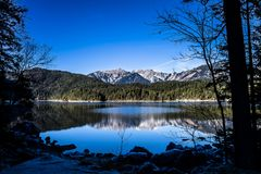 Alpine Mountain Reflections. Alpine mountain reflection in a lake in Bavaria, Germany Stock Photography