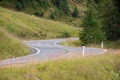 Alpine mountain road. Curvy alpine mountain road in the alps Stock Image