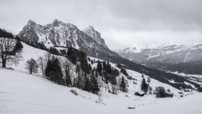 Alpine mountain scenery. Moody winter scenery of alpine mountains covered with snow stock photo
