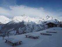 Alpine mountain view in europe winter snow Stock Photos