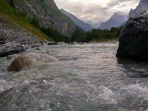 Alpine mountain water stream on sunset in Switzerland Royalty Free Stock Photos