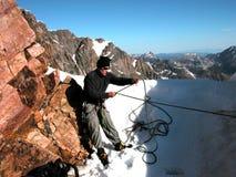 Alpine Mountaineering, Granite Peak Snow Bridge. Crossing the Granite Peak Snow Bridge, Montana stock photography