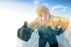 Alpine mountaineering. Happy active hiker man showing thumbs up, everything is OK and good. Alpine mountaineering. Photography with double exposure effect Royalty Free Stock Image