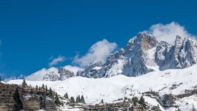 Alpine mountains in bright and warm winter sun Royalty Free Stock Photo