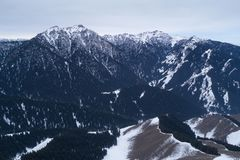 Alpine mountains and forest. Aerial view of the Alpine mountains and forest Royalty Free Stock Photos