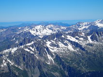 Alpine mountains range landscape from Aiguille du Midi. Alpine mountains range landscape in beauty French, Italian and Swiss ALPS seen from Aiguille du Midi at Stock Photography