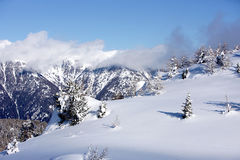 Alpine mountains. Winter snow clouds Royalty Free Stock Photos