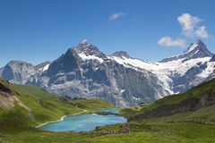 Alpine panorama. Panorama view towards the Bachsee and the Wetterhorn and the Schreckhorn in the Swiss Alps Royalty Free Stock Photography