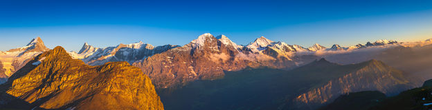Alpine Panorama: Eiger North Face, Swiss Alps. Glowing Eiger North Face in summer stock photos