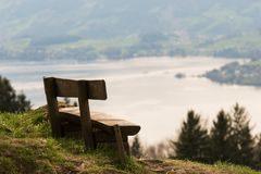 Alpine panorama from Rigi mountain. Canton Schwyz, Switzerland. Lucerne lake. Switzerland landscape and nature. Old wooden bench stock image