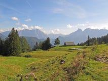 Alpine panorama scene with hut Royalty Free Stock Photos