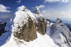 Alpine panorama with snow covered cliffs Stock Photo