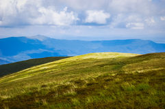 Alpine pasture on a cloudy day royalty free stock photo